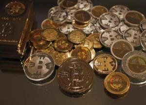 Some of Bitcoin enthusiast Mike Caldwell's coins are pictured at his office in Sandy, Utah