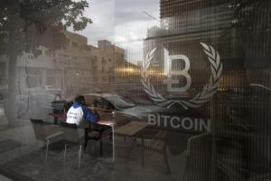 People sit inside the Bitcoin Embassy in Tel Aviv
