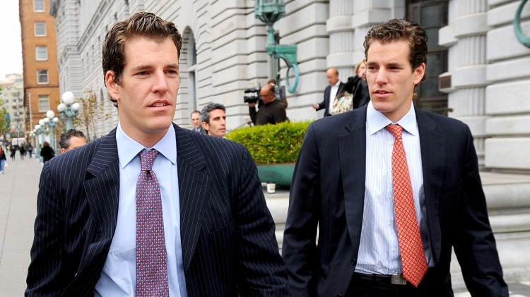Cameron Winklevoss, right, and his twin brother Tyler leave a federal appeals court in San Francisco, California, U.S., on Tuesday, Jan. 11, 2011. Facebook Inc.'s settlement of claims that its founder Mark Zuckerberg stole the idea for what became the world's largest social-networking website should be undone, former college classmates of Zuckerberg told an appeals court. Photographer: Noah Berger/Bloomberg *** Local Caption *** Cameron Winklevoss; Tyler Winklevoss
